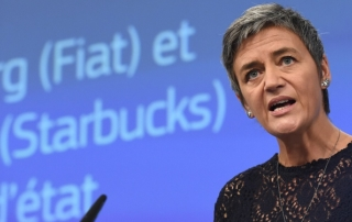European commissioner for competition Margrethe Vestager holds a press conference on the EU decision to set out a template for recovering unpaid taxes and preventing tax avoidance by multinationals at the European Commission in Brussels on October 21, 2015. The European Union ordered Starbucks and Fiat to each repay up to 30 million euros in back taxes in a landmark tax avoidance case pursued in the wake of the LuxLeaks scandal. AFP PHOTO / EMMANUEL DUNAND        (Photo credit should read EMMANUEL DUNAND/AFP/Getty Images)